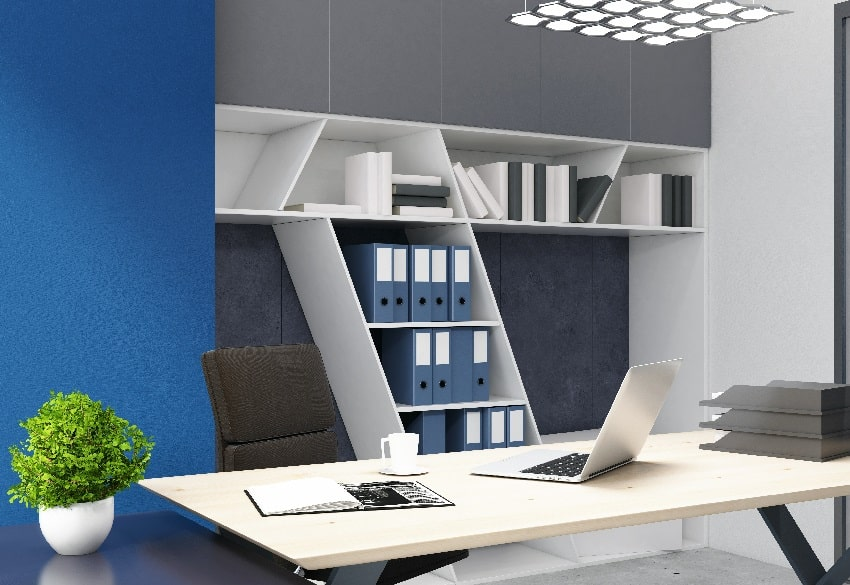home office interior with bookshelves white table laptop and plant