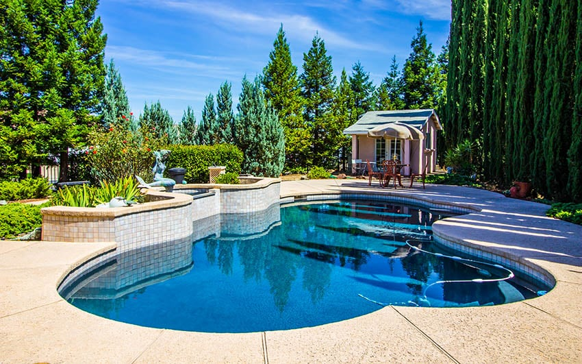 Home with salt finish concrete pool
