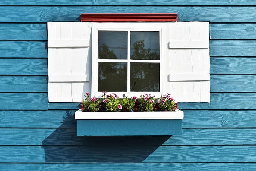 House exterior with blue paint white shutters trim