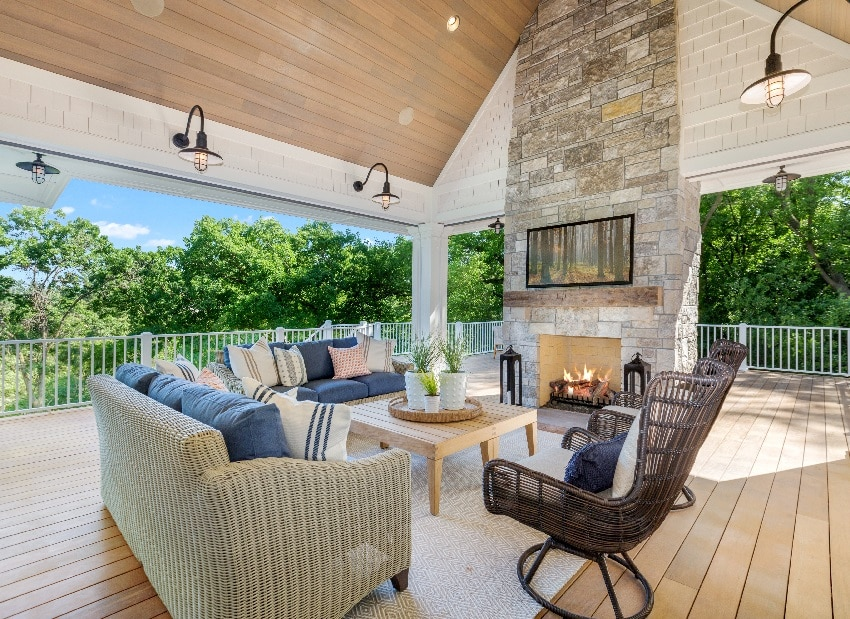 huge outdoor wood deck with sofas beautiful vaulted covering and stone fireplace