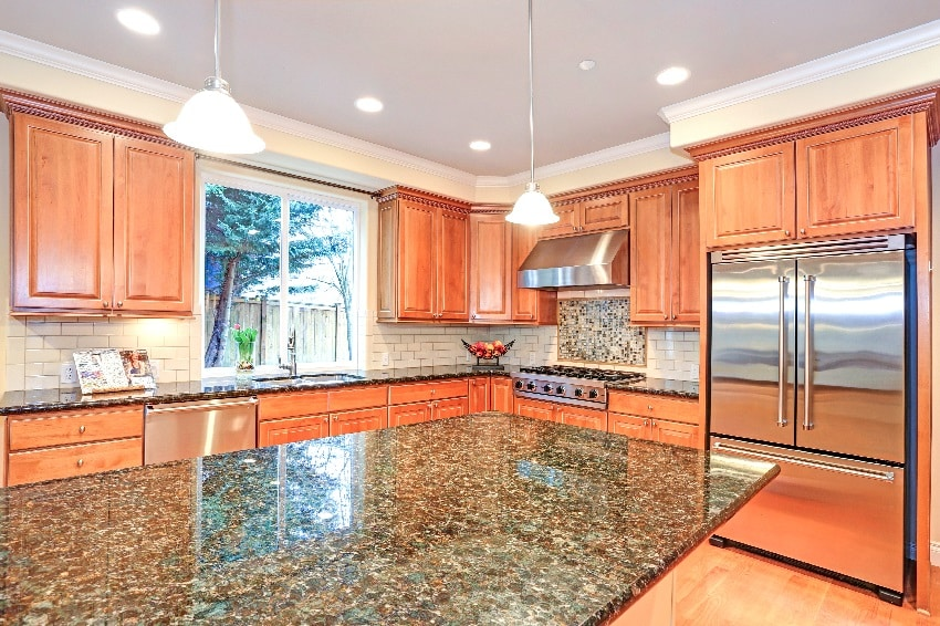 kitchen with an island light oak wood cabinets and viking appliances