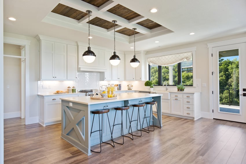 White gourmet kitchen with coffered ceiling