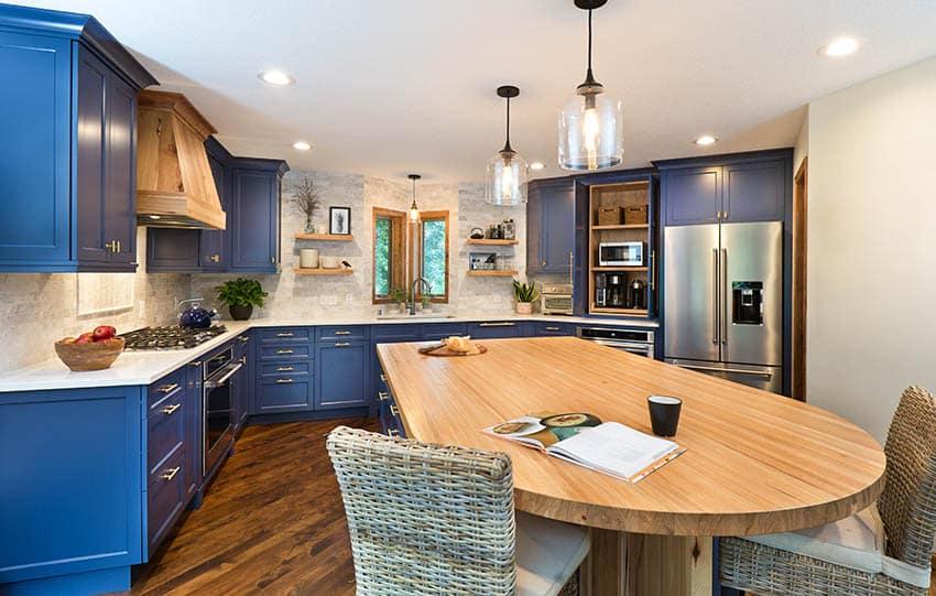 Kitchen with edge grain butcher block wood countertop island quartz counters blue cabinets