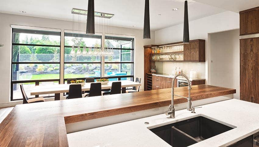 Kitchen with face grain butcher block wood countertop breakfast bar