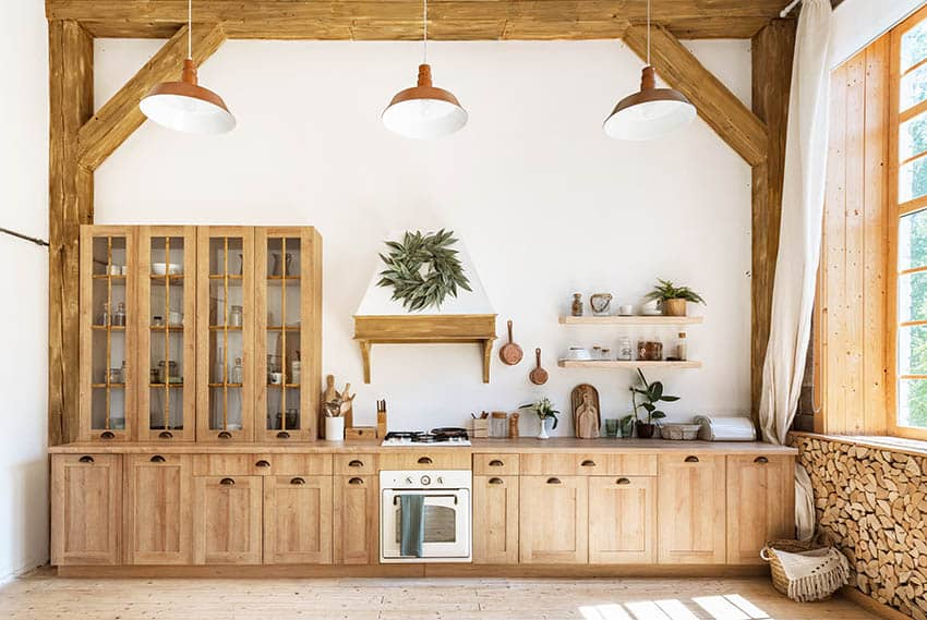 Kitchen with oak cabinets white painted walls high ceiling