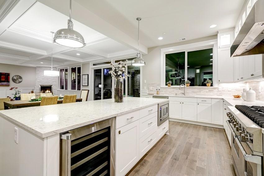 kitchen with white cabinets marble countertops stone subway tile backsplash and gorgeous kitchen island