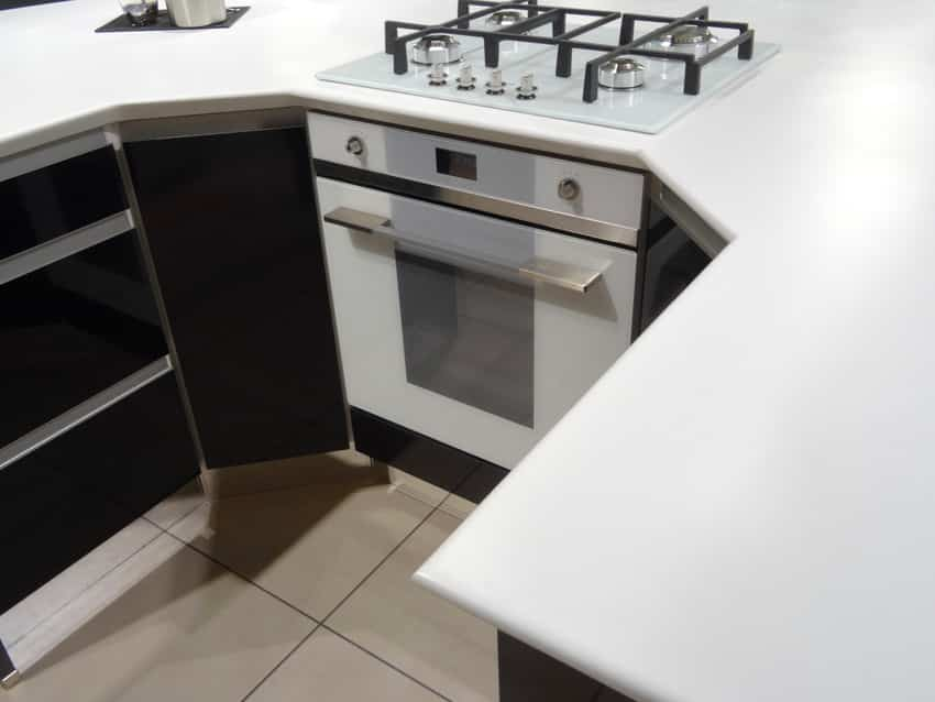 Kitchen with white solid surface corian countertops