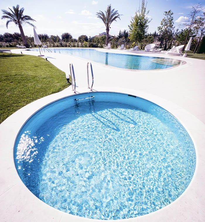 Large circular plunge pool next to rectangular pool