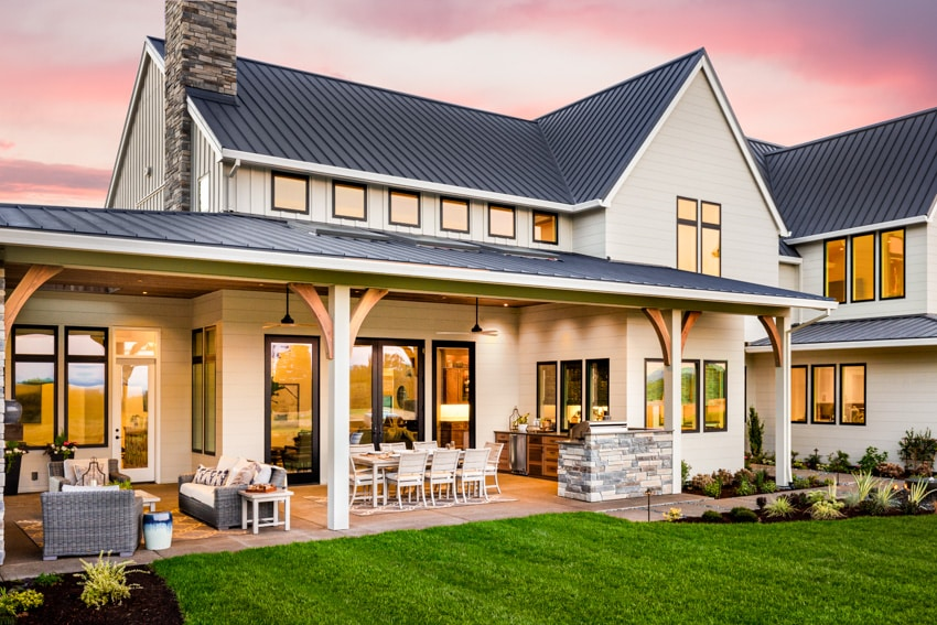 Large house with folding patio door and outdoor furniture
