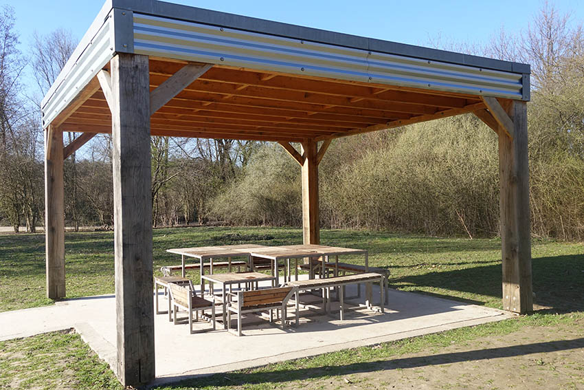 Large modern pavilion with concrete patio outdoor dining