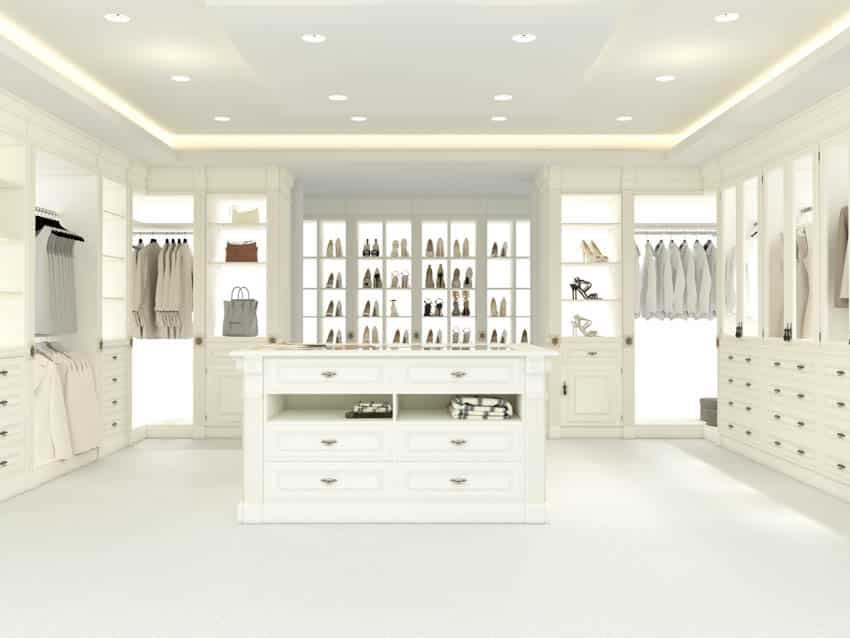 Large walk in closet with lighted shoe racks white flooring
