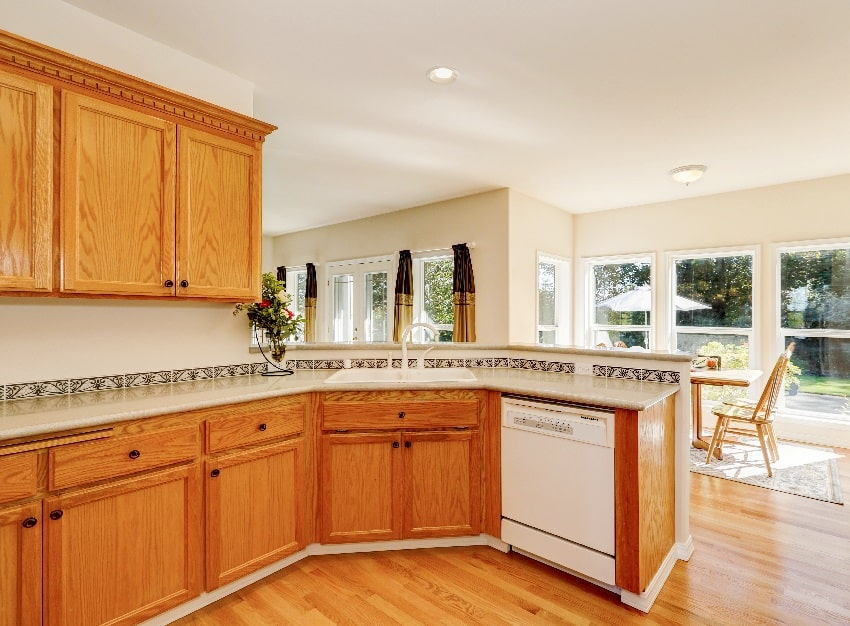 light brown kitchen cabinets and white appliances in the kitchen room