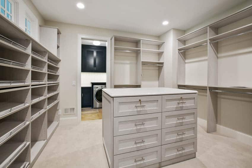 Light gray walk in closet with island