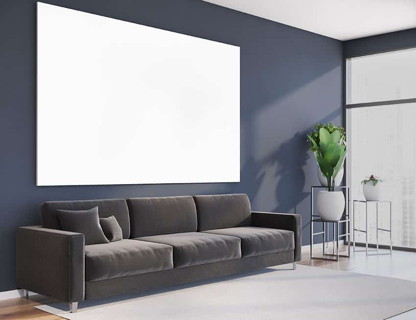 Living room with dark blue wall paint