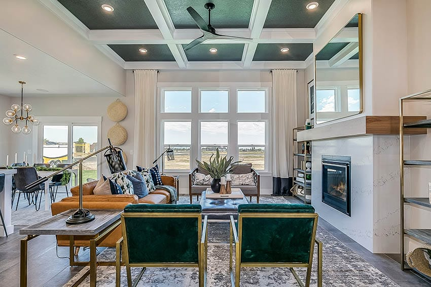 Living room with green and white painted coffered ceiling large fireplace