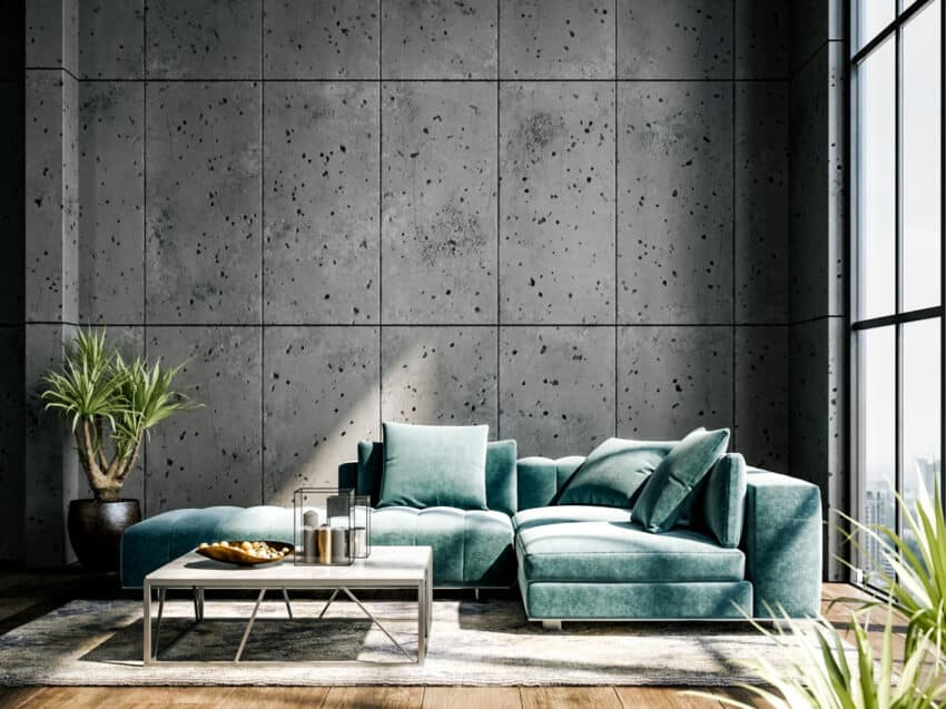 Living room with green couch large windows and concrete wall