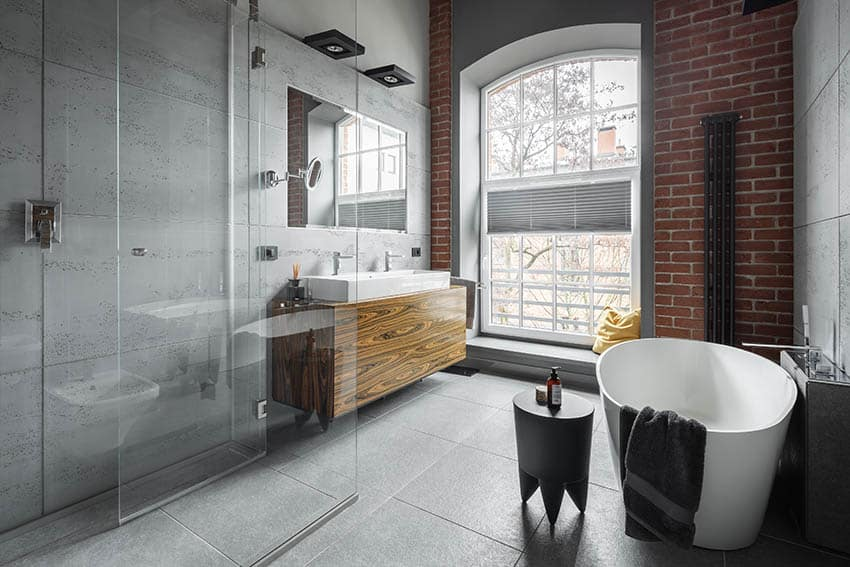 Loft bathroom with concrete floor shower