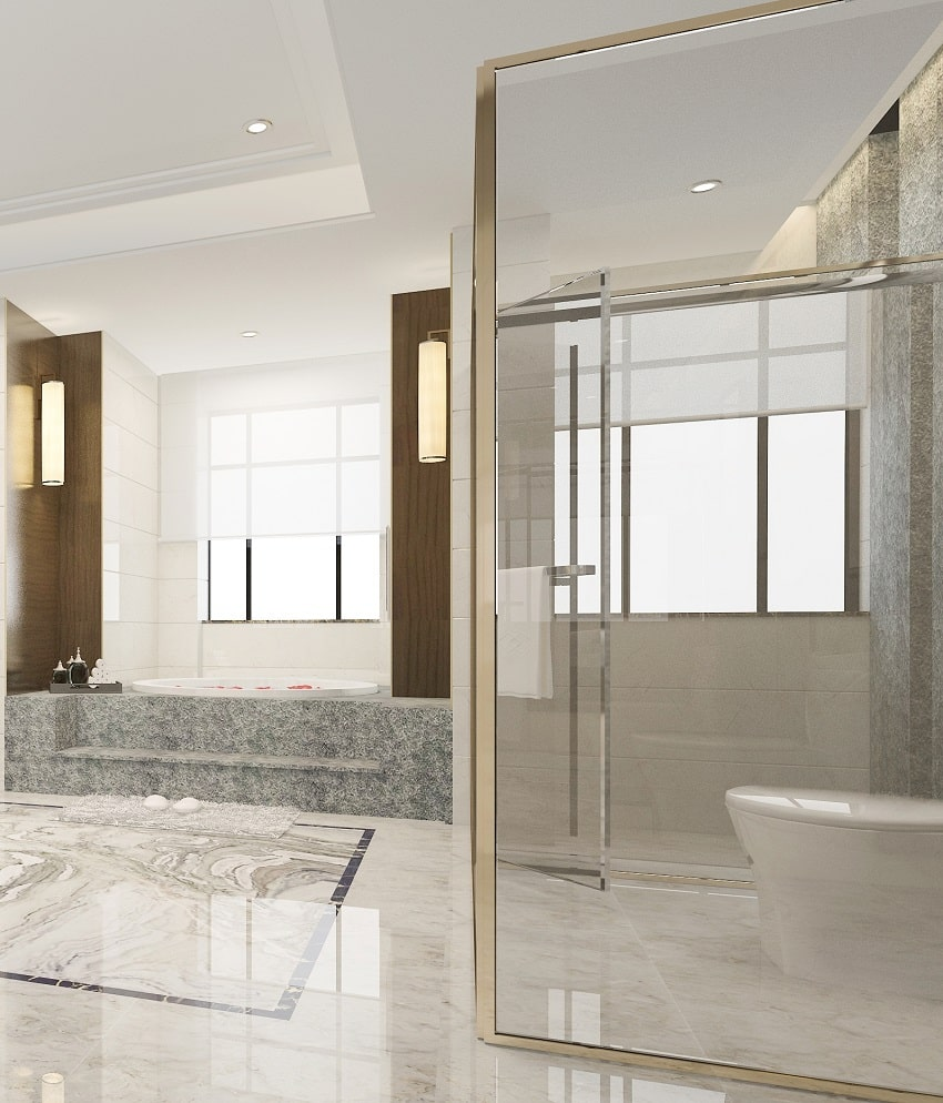 luxury modern design bathroom and toilet with marble tiles and glass shower stall
