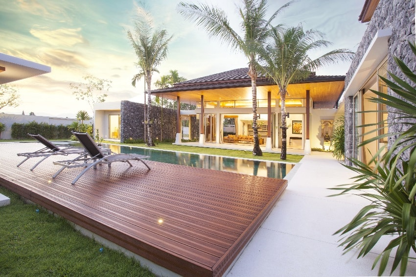 luxury tropical modern island home exterior with composite decking and swimming pool