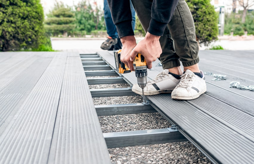 Man installing fasteners on composite deck