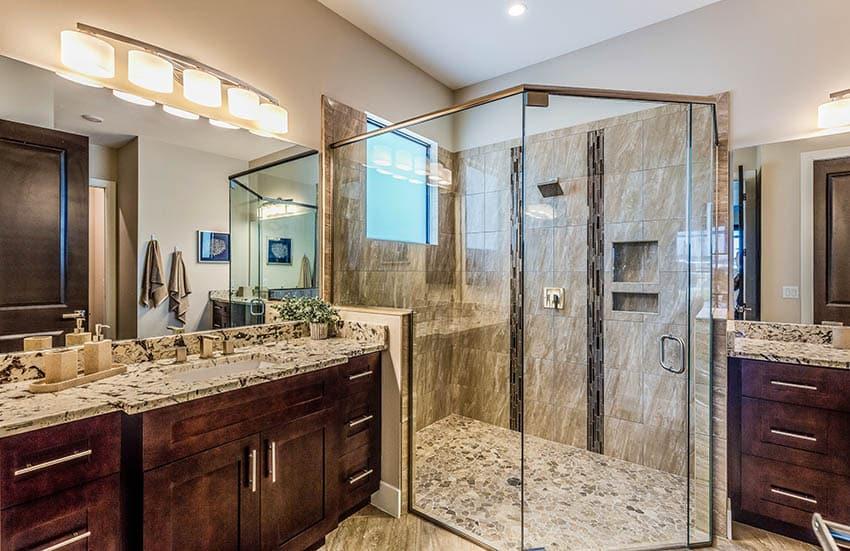 Master bathroom with river rock shower floor dual vanities granite countertops
