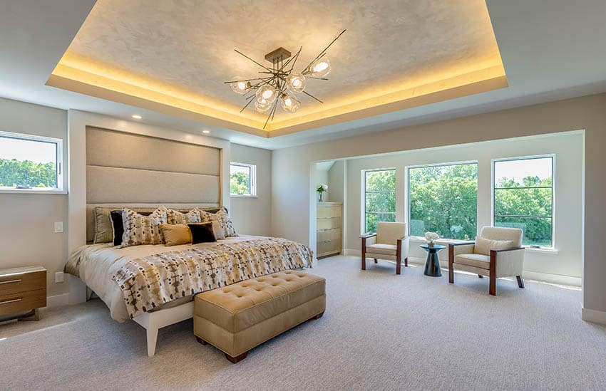 Master bedroom with indirect accent light tray ceiling platform bed