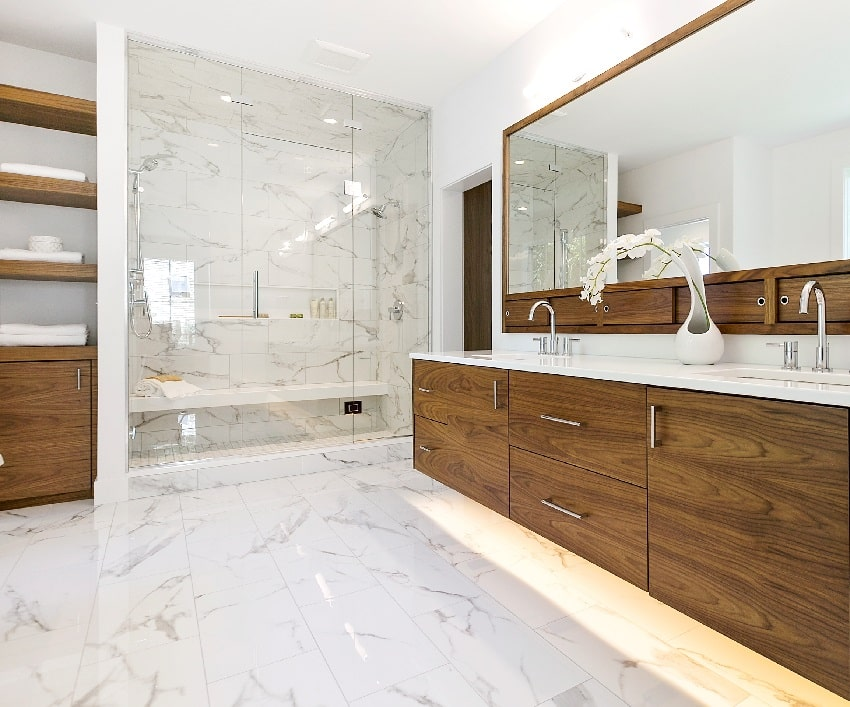 mid century modern look bathroom with wooden cabinets mirror and white marble tiled shower
