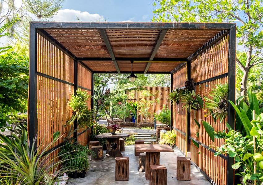 Modern backyard with pendant pergola lighting and outdoor furniture