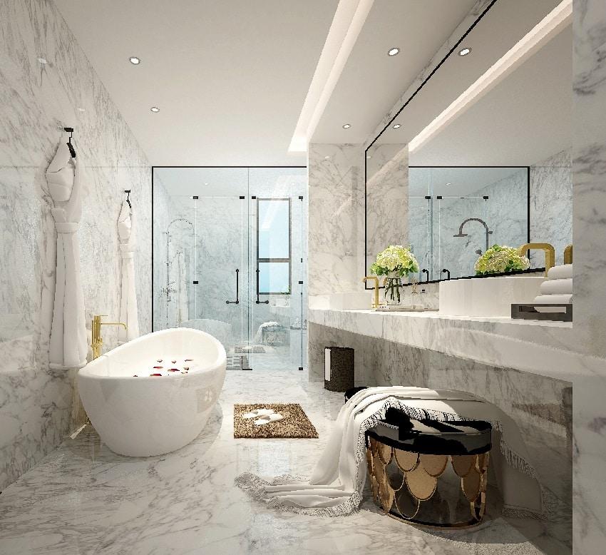 modern bathroom with a bath shower bathrobe mirror and bathroom marble tiles