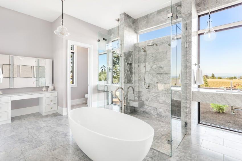 Modern bathroom with white bathtub shower and bench