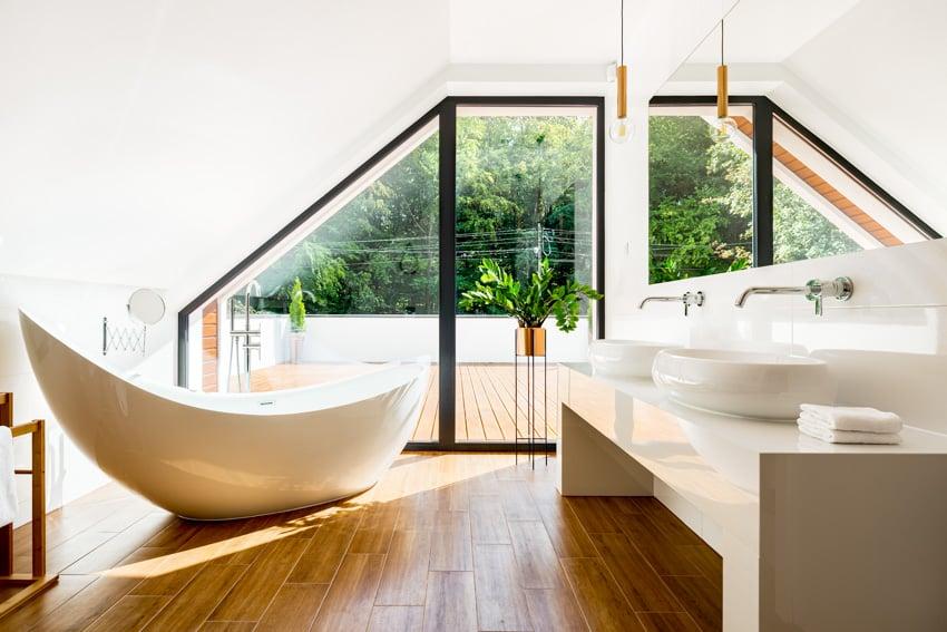 Modern bathroom with wood flooring bathtub and white sink