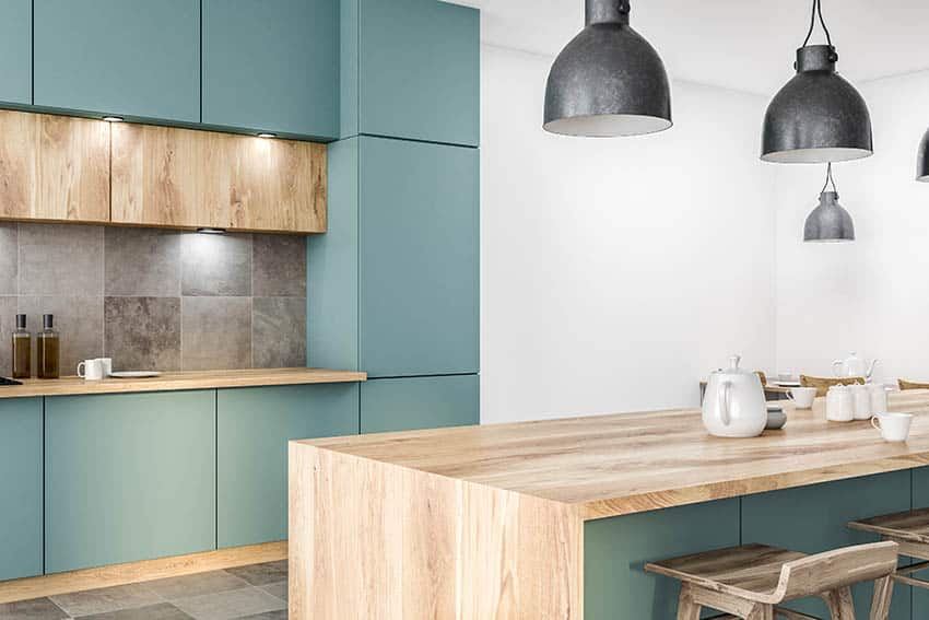 Modern kitchen with green cabinets wood countertops stone tile floors