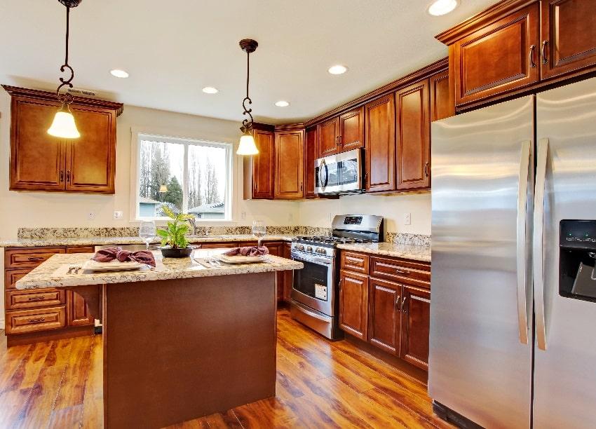 modern kitchen with hardwood floor dark oak wood cabinets and granite counter tops