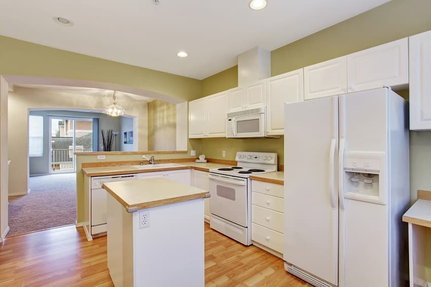 modern kitchen with light green wall and hardwood floor