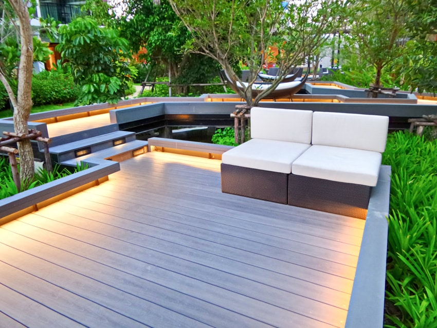 Modern outdoor deck with sofa chairs and lighting