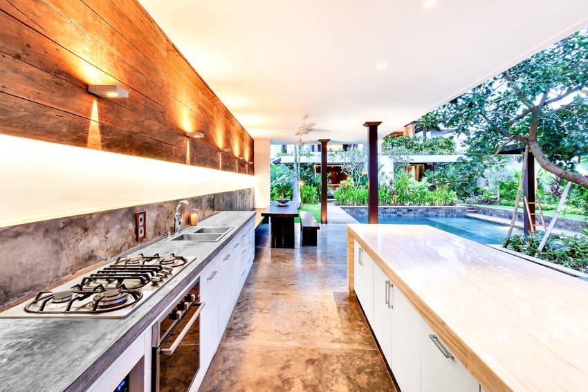 Modern outdoor kitchen with stove countertop island and lighting