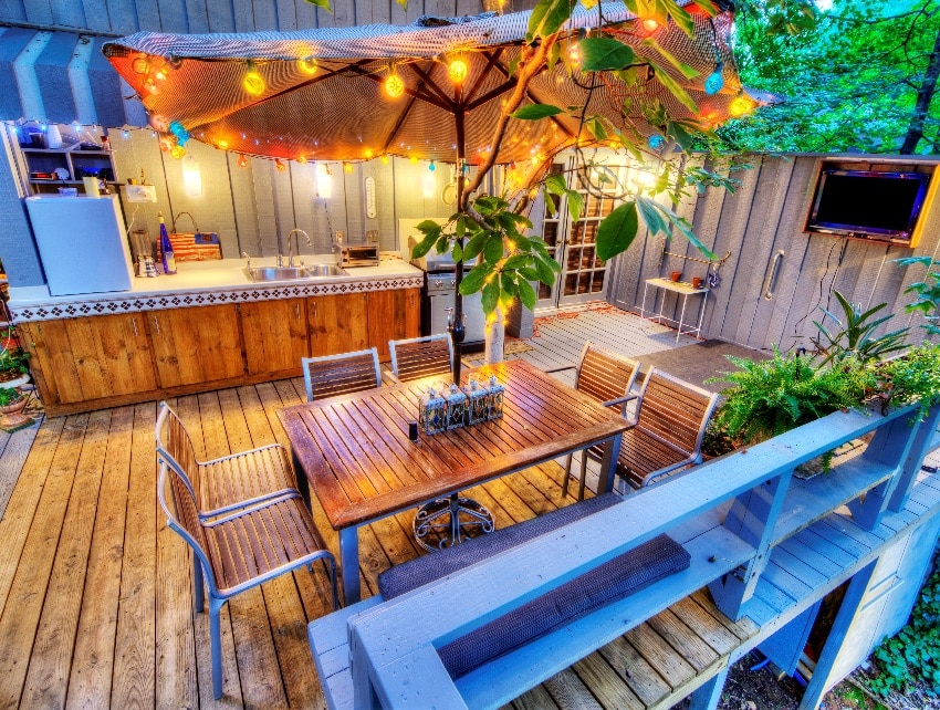 nice wood deck with string lights furniture at a home in the woods