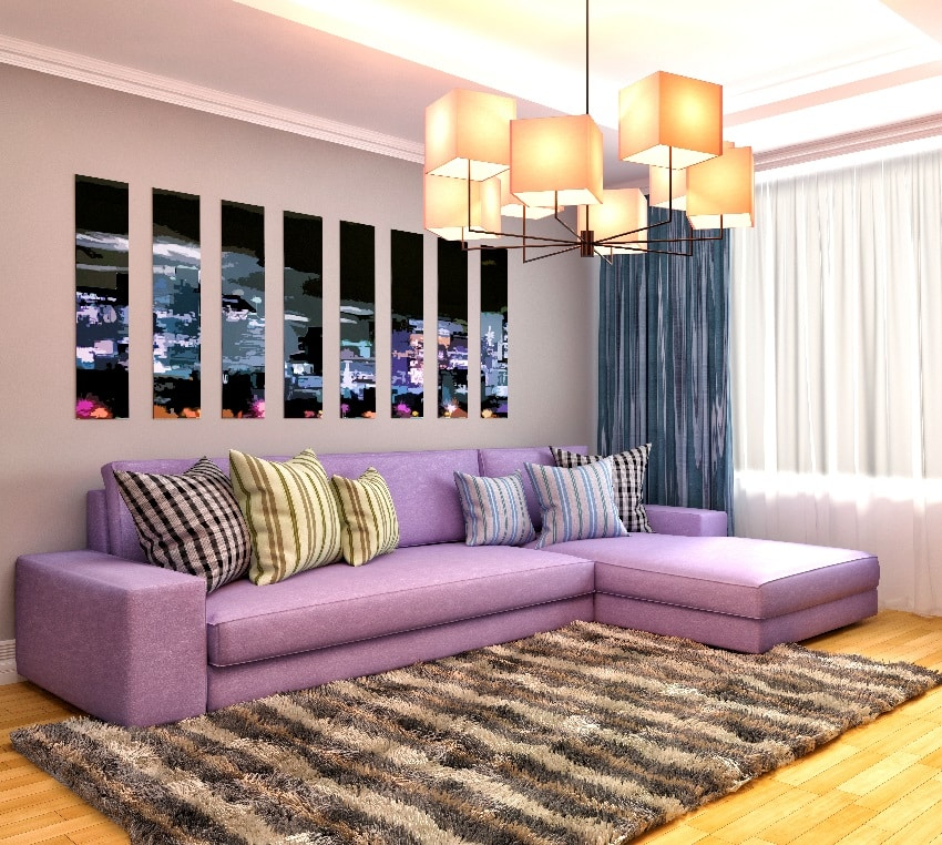 old rose wall with purrple sofa and brown stripes carpet