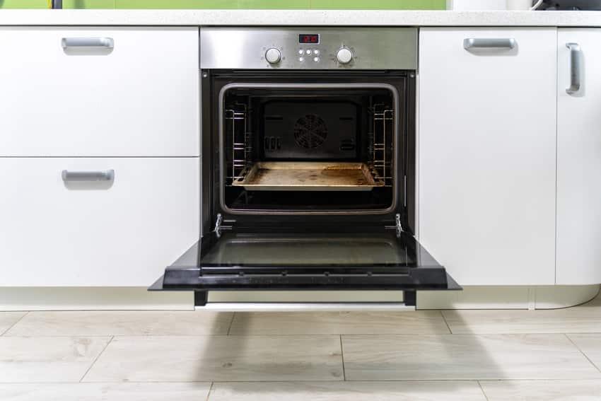 Open oven door in a bright kitchen