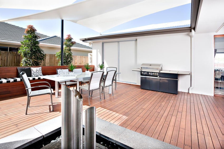 Outdoor kitchen and relaxing area of a modern house