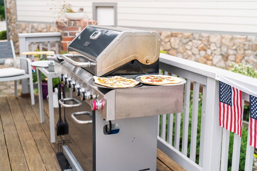 Outdoor kitchen with a stainless steel gas grill