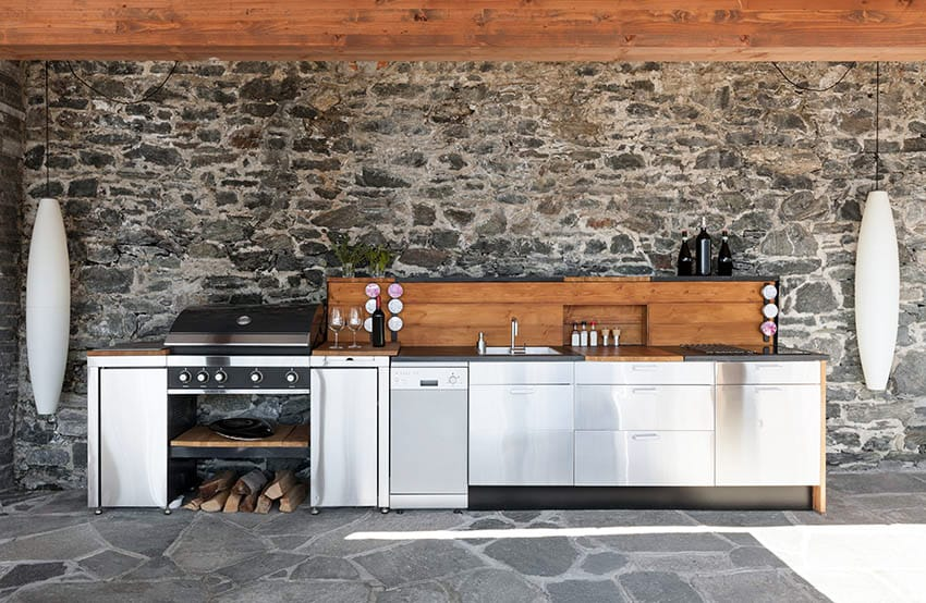 Outdoor kitchen with gray flagstone patio and grill