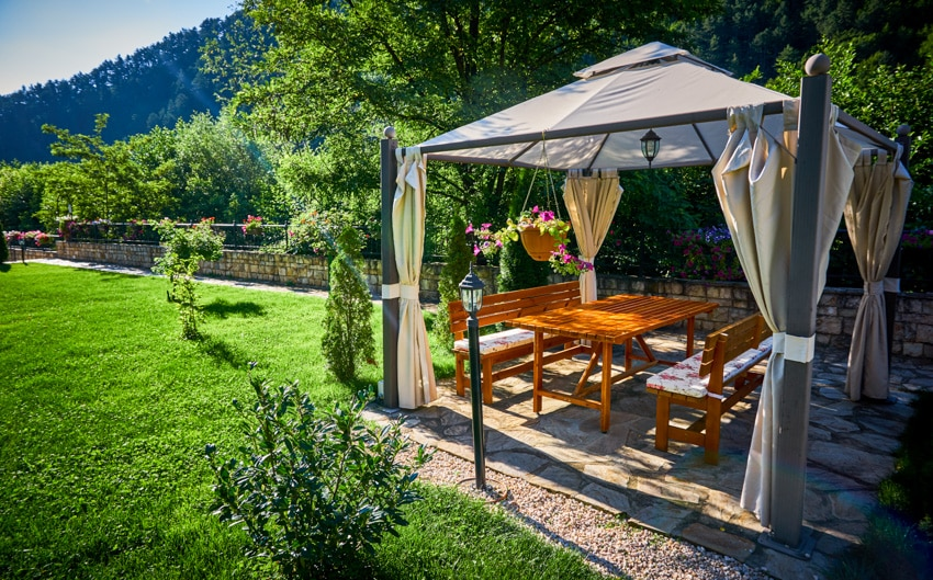 Outdoor pergola with light mounted on stands in garden