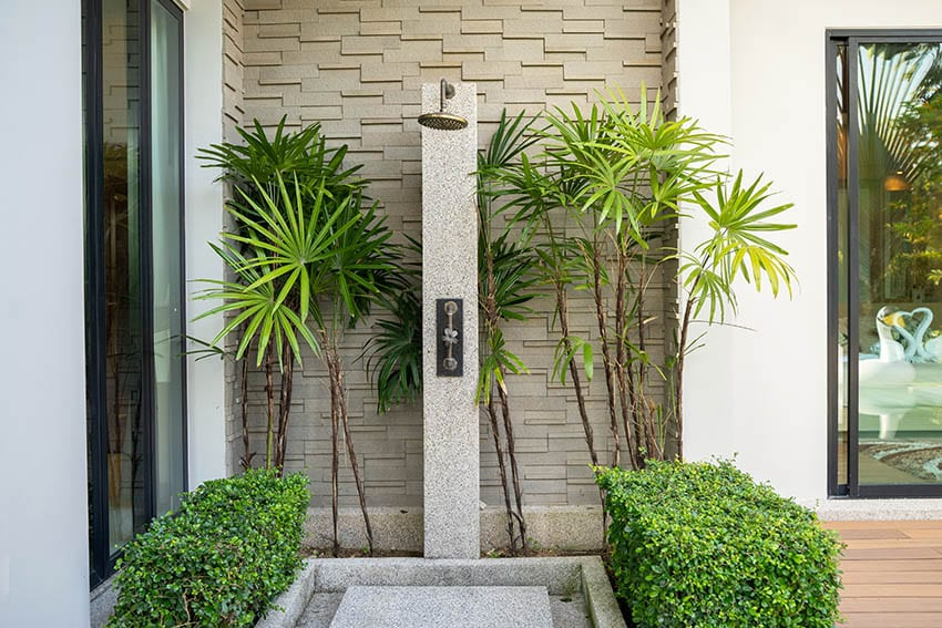 Outdoor shower with concrete floors