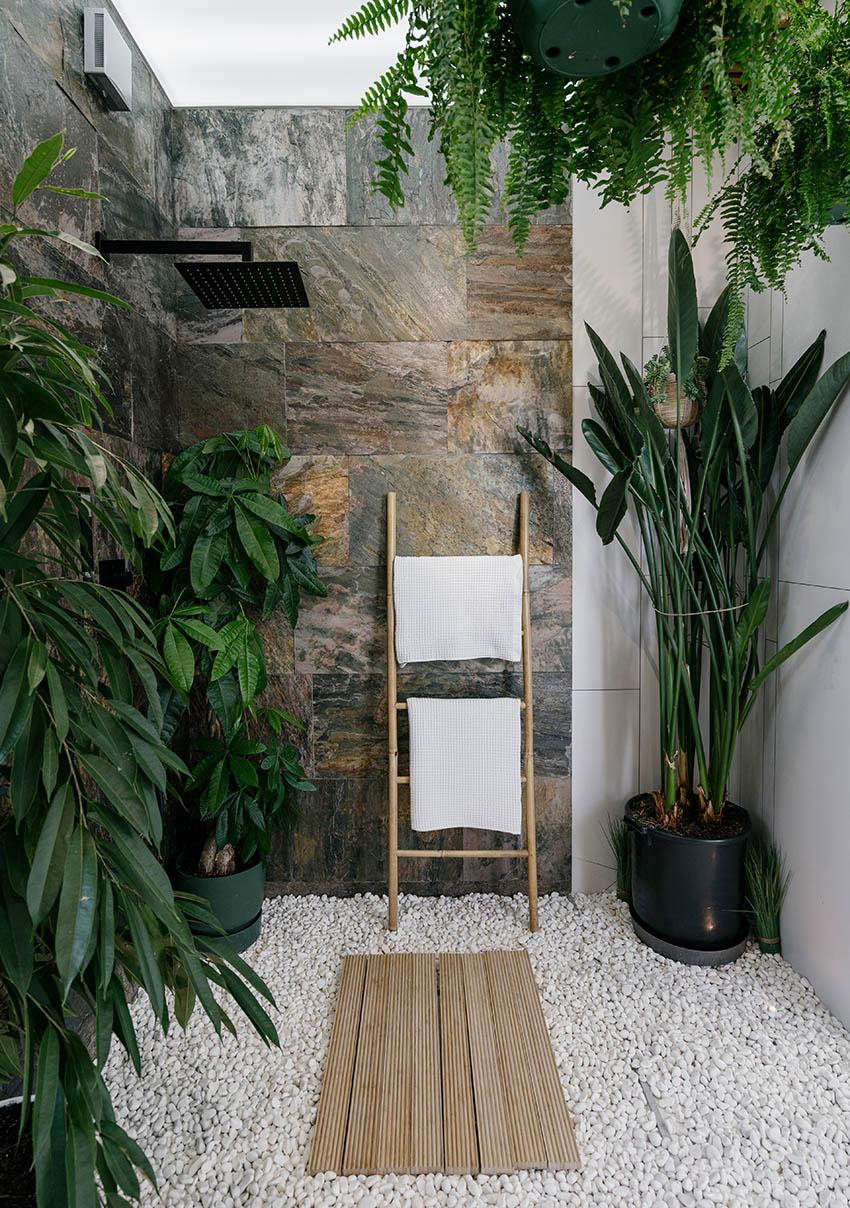Outdoor shower with pebble floor
