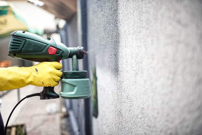 Paint sprayer on house exterior