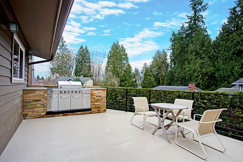 Painted concrete patio with outdoor kitchen dining table