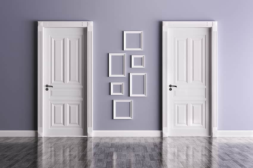 White prehung doors with blue wall