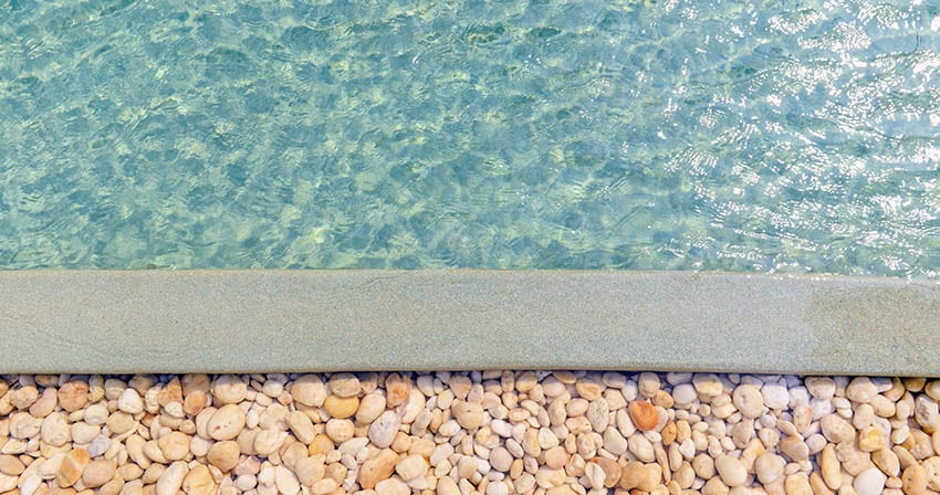Pea gravel pool deck