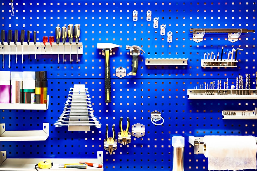 Pegboard with hanging tools